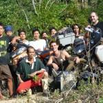 13 village helpers pose