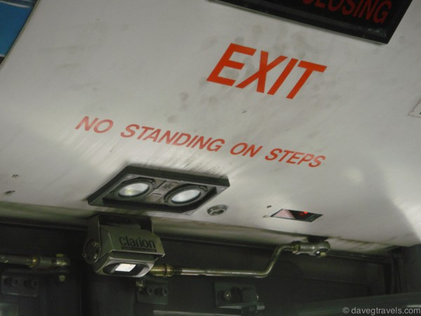 From inside of a bus. The steps wouldn't have enough room to stand and read the sign at the same time