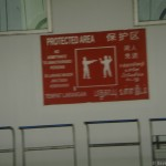 Singapore Signs –  Protected area – theyll shoot you – really